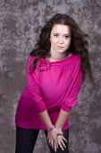 Girl With Long Hair In A Pink Blouse