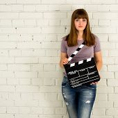 Young Girl Holding A Clapboard