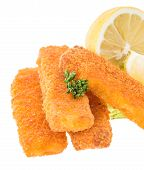 Fish Fingers With Lemon Pieces On White
