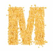 M, alphabet,Letter from Split and hulled mung beans on isolated white