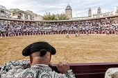 Detail Of Bullfighter Bald And Slightly Fat Looking The Bull During A Bullfight Held In Ubeda