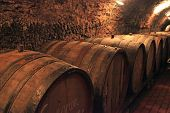 picture of wine cellar  - Wine barrels stacked in the old cellar of the winery - JPG