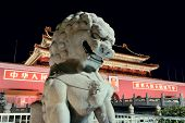 BEIJING, CHINA - APR 1: Tiananmen exterior with lion statue at night on April 1, 2013 in Beijing, China. It is a famous monument in Beijing and serves as a national symbol.