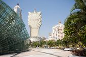 MACAU, CHINA - NOVEMBER 2, 2012: Casinos buildings and Illuminated glass installation in modern area