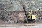 Excavator In A Granite Quarry