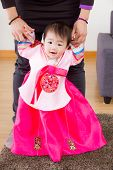 Traditional korean costume baby learn to walk