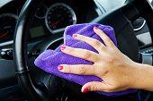 Woman's Hand With Microfiber Cloth Polishing Wheel Of A Car