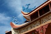 Chinese dragons in blue on the roof