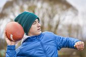 Teen with rugby ball