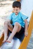 Preschooler Boy On Slide