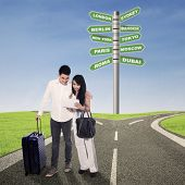 Choosing Destination With Digital Tablet poster