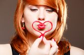 Redhaired Girl Holding Red Heart Love Blowing Kiss. Valentines Day.