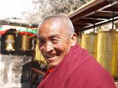 LHASA, TIBET - CIRCA MARCH 2008: Unknown buddhist monk smiles in the streets of Lhasa circa March 20