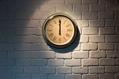 Vintage Clock On A White Brick Wall