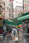 HONG KONG, CHINA - MAY 13 : Famous Temple Street after raining in Hong Kong, China on 13th May 2014.