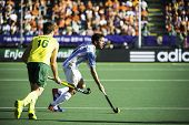 THE HAGUE, NETHERLANDS - JUNE 13: Argentinian player Brunet passes Australian player Gohdes during t