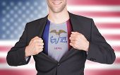 Businessman Opening Suit To Reveal Shirt With State Flag