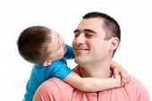Happy Child Embracing His Father Isolated On White