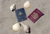 Passports On Sandy Tropical Beach With Shells