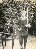 POLAND, CIRCA 1930:  Vintage photo of little boy at his First  Communion