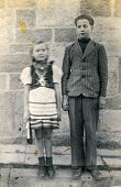 POLAND, CIRCA DECEMBER 1947:  Vintage photo of brother and sister