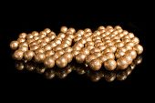 Gilded Balls On A Black Background