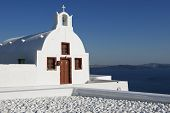 Beautiful white church with a view to caldera in Oia, Santorini, Greece.