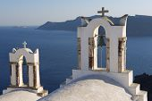Church bell towers in Oia, Santorini island, Greece.