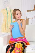 Young fashion designer draws new sketches collection