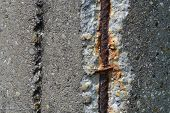 Rusty Steel Rebars In Old Concrete