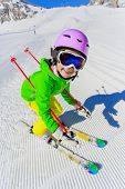 Skiing, winter, ski lesson - young skier on ski run