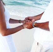 Hands of loving couple on the tropical beach. Vacation.