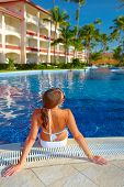 Woman in the pool. Vacation at caribbean resort