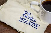 do things you love - motivational handwriting on a napkin with a cup of espresso coffee