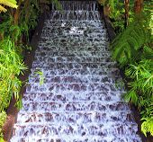 Picturesque cascading waterfall in a tropical park