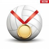 Sport gold medal with ribbon for winning volleyball hangs on the ball.