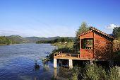 Wooden veranda on the mountain river Katun.
