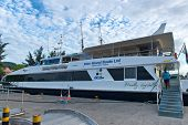 MAHE, SEYCHELLES - 21 OCTOBER 2014 - Large Modern Cruise Ship Resting at Victoria Harbour in Seychelles Island on 21 October 2014