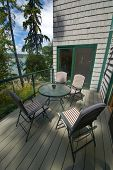 Front deck with outdoor table poster