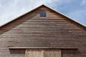 Looking Up At The Top Of A Gabled Roof On A Wooden Barn