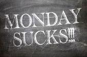 Monday Sucks written on blackboard