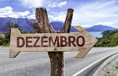 December (In Portuguese) sign with a road background