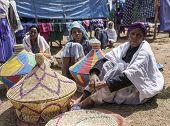 OROMIA, ETHIOPIA: NOVEMBER 5, 2014: Unidentified weavers sell traditional baskets in an outdoor market in Oromia, Ethiopia