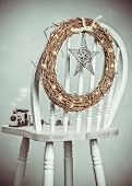 Christmas wreath on back of chair