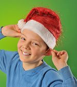 Boy With Santa Claus Hat On Green Background
