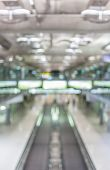 Blurred Image Of Moving Modern Escalator Way In The Airport Hall.
