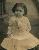 CANADA - CIRCA 1900s: An antique photo shows  portrait of a  in a festive white dress.