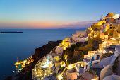 Oia village on Santorini in sunset, Greece.