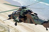 pic of missles  - Australian Army Tiger reconnaissance chopper flies low over the coastline.