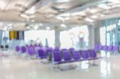 Blurred Image Of Empty Chairs In Departure Lounge Of Airport Terminal.